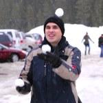 Man juggle snowballs — Stock Photo