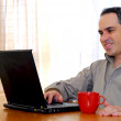 Man with laptop - Stockfoto