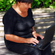 Mature woman computer - Stock Photo