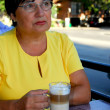 Stock Photo: Mature woman coffee