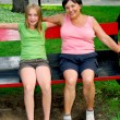 Family on swings — Stock Photo