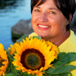 Woman sunflowers — Stock Photo