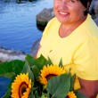 Stock Photo: Woman sunflowers
