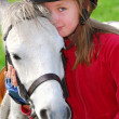 Girl and pony — Stock Photo