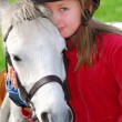 Girl and pony - Stock Photo