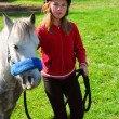 Stock Photo: Girl and pony