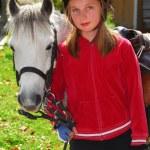 Girl and pony — Stock Photo