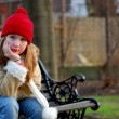 Girl on bench — Stock Photo