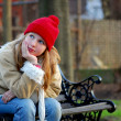Girl on bench - Stock Photo