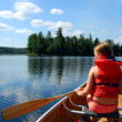 Child in canoe — Stockfoto