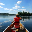 Child in canoe — Stock Photo