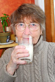 Woman glass milk — Stock Photo