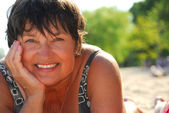 Mature woman beach — Stock fotografie