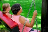 Family swings — Stock Photo