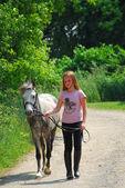 Girl walk pony — Stock Photo