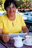 Mature woman reading — Stock Photo