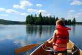 Child in canoe — Stock Photo