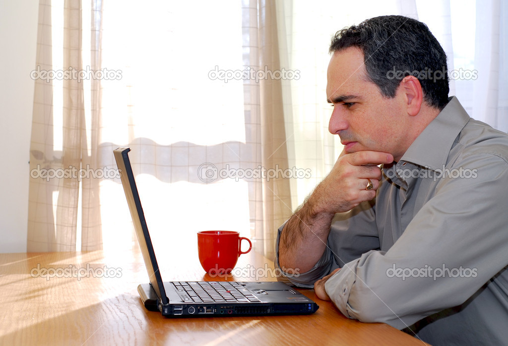 Man sitting at a desk and looking into his computer — Stock Photo #4953802