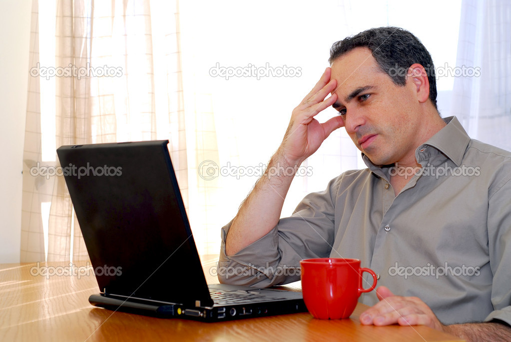 Man sitting at a desk and looking into his computer — Stock Photo #4953806