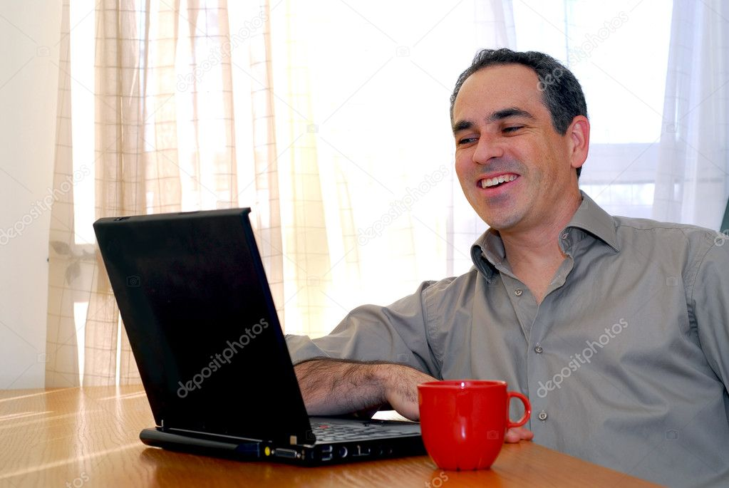 Man sitting at a desk and looking into his computer — Stock Photo #4953810