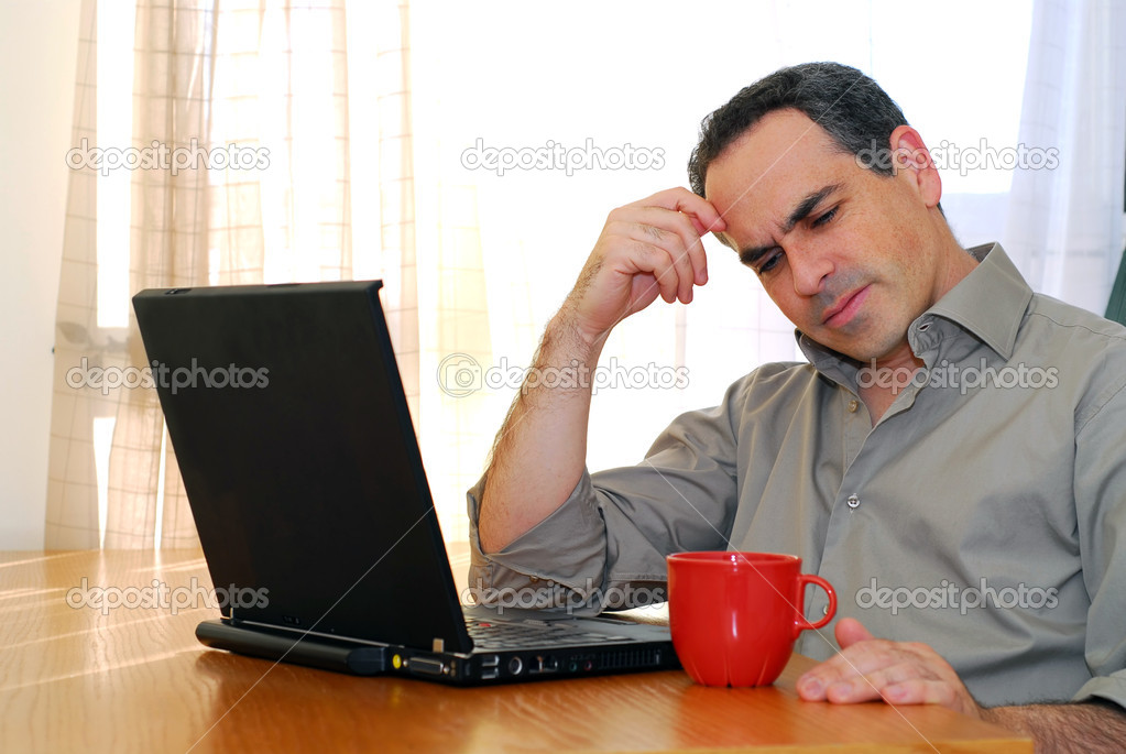 Man sitting at a desk and looking into his computer — Stock Photo #4953820