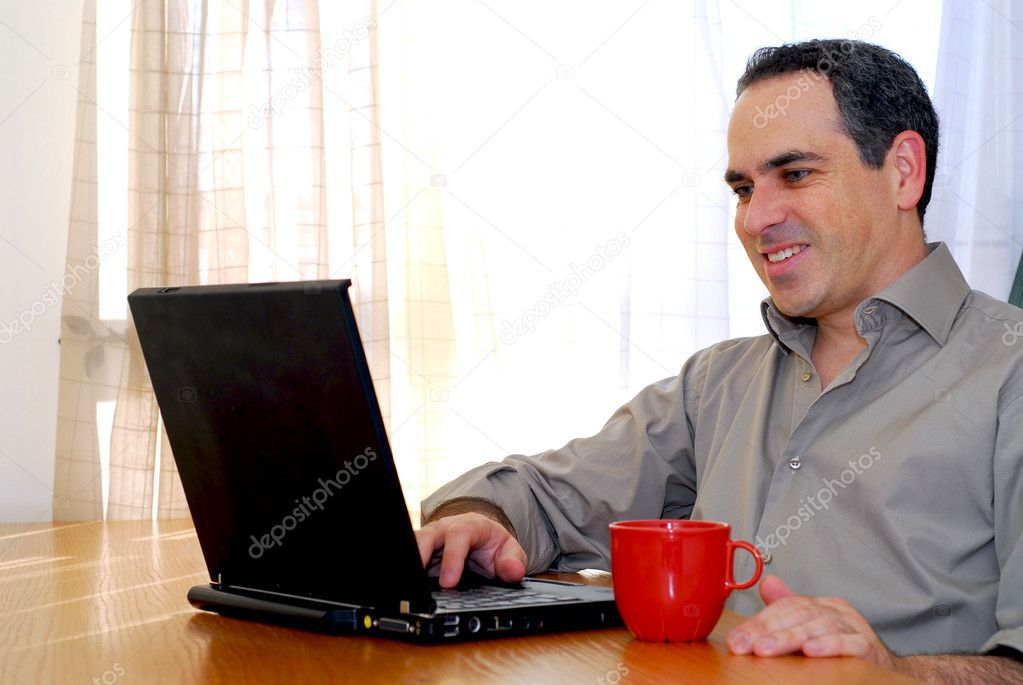 Man sitting at a desk and looking into his computer — Stock Photo #4953823