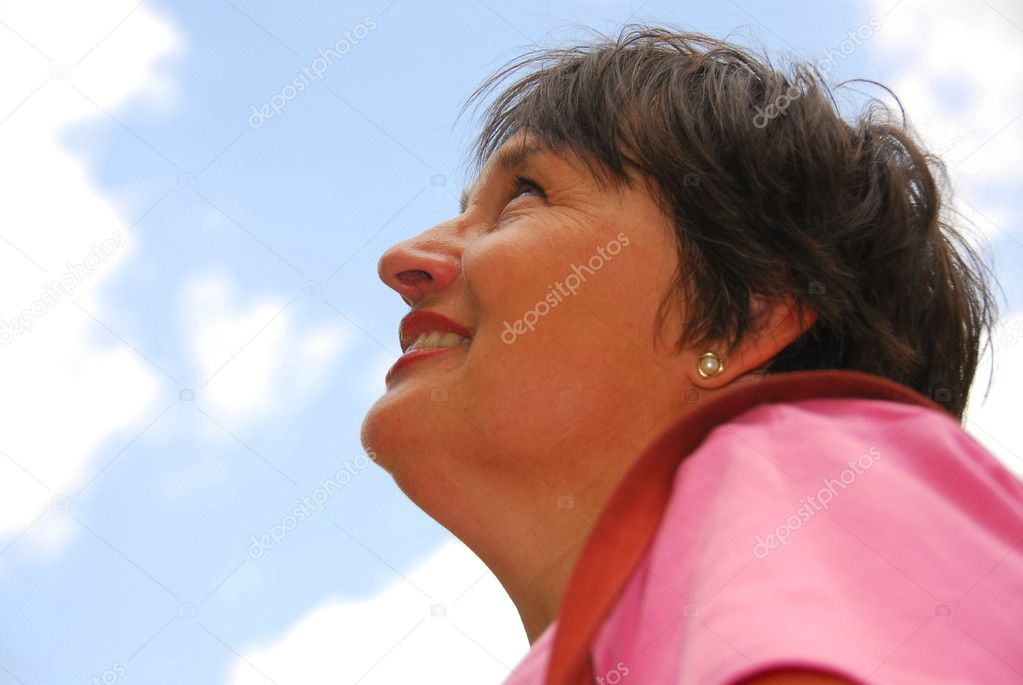 Optimistic woman looking up blue sky — Stock Photo #4954022