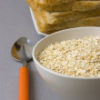 Bowl with oats and bread — Stock Photo