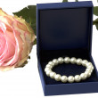 Bracelet in the box and  rose, isolated - Stock Photo