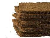Slice of dark bread, isolated — Stockfoto