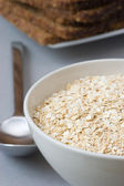 Bowl with oats, isolated — Stock Photo