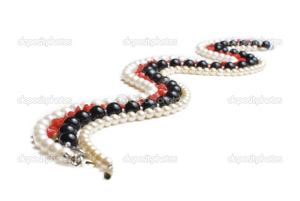 Pearl, agate and coral necklases isolated on white background. Curved like the river or snake  Stock Photo #3128307