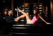 Pair of lovers are trying on new shoes — Stock Photo