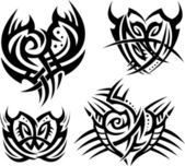 Tribal hearts and shields — Stock Vector
