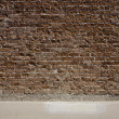 Red brick wall and sidewalk - Stock Photo
