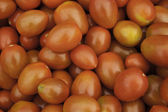 A background of ripe red tomatoes — Stock Photo