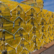 Commercial lobster cages on a pier in New England - Stock Photo