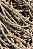 Background image of coiled, used rope — Stock Photo