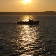 Commercial fishing boat at sunset — Stock Photo