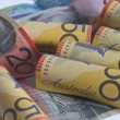 Australian dollars rolled up - Stock Photo