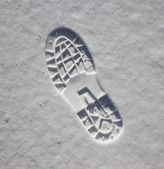 Footprint in the snow — Stock Photo