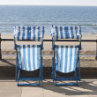 Empty deckchairs looking over the sea — Stock Photo