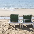 Royalty-Free Stock Photo: Two green deckchairs overlooking the sea