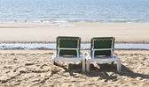 Two green deckchairs overlooking the sea — Stock Photo