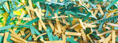 Green and yellow shredded paper — Stock Photo