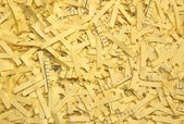 Shredded yellow paper — Stock Photo