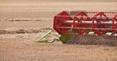 Harvester blades cutting the wheat — Stock Photo