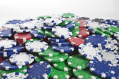 Poker chips scattered — Stock Photo