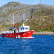 Stock Photo: Fishing boat in fjord of northern Norway