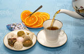 Teapot, cup of tea and cakes — Stock Photo